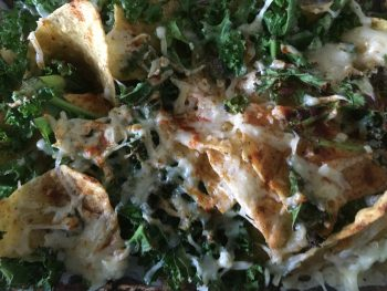 Nachos with Kale, Cheese, Smoked Paprika and maybe beans
